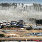114078-an-aerial-photo-shows-a-residential-area-being-hit-by-a-tsunami-in-nat