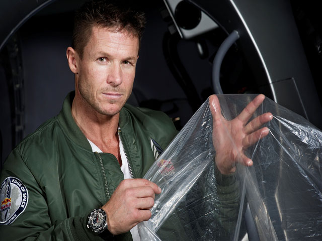 Pilot Felix Buamgartner of Austria shows a piece of the balloon material during the Red Bull Stratos egress training in Lancaster, California, USA on February 23, 2012.