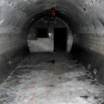 making-our-way-into-the-tunnels-we-passed-through-a-series-of-cylindrical-passages-separated-by-concrete-bulkheads