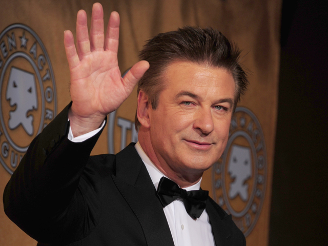 Actor Alec Baldwin waves after getting t