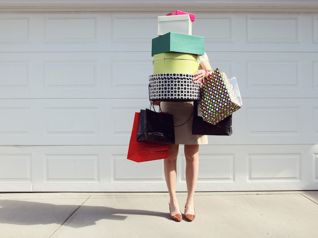woman-with-shopping-bags-and-boxes