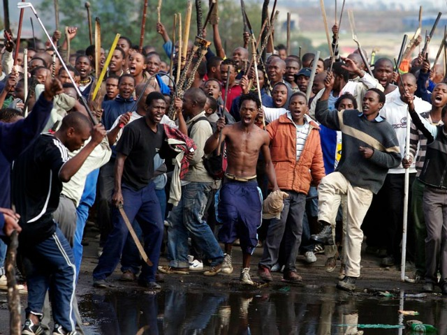 8 of 17.  A mob on the rampage in Ramaphosa, Johannesburg.