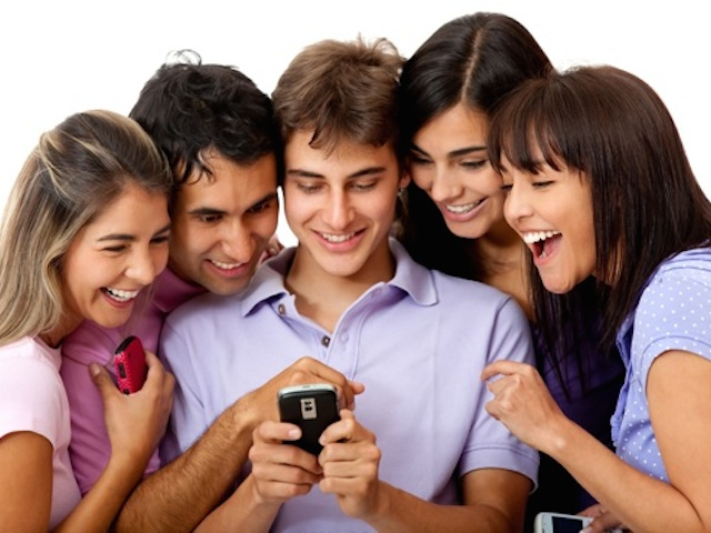 group-of-students-looking-at-phone