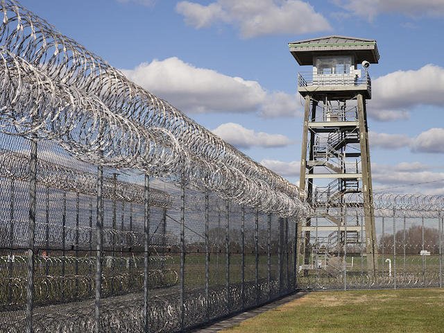 2-prison-fence-watch-tower-and-barbed-roberto-westbrook