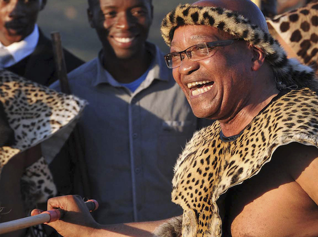 """South African President Jacob Zuma dances as he marries his fiancee Bongi Ngema at a traditional ceremony known as """"Umgcagco"""" at his home in Nkandla, in South Africa's KwaZulu Natal province, in this handout picture supplied by the Government Communication and Information Service, April 20, 2012. Zuma, who turned 70 last week, married for the sixth time and Ngema is his fourth current wife. Polygamy forms part of Zulu culture and is legal in South Africa. REUTERS/Elmond Jiyane/GCIS/Handout (SOUTH AFRICA - Tags: POLITICS) FOR EDITORIAL USE ONLY. NOT FOR SALE FOR MARKETING OR ADVERTISING CAMPAIGNS. THIS IMAGE HAS BEEN SUPPLIED BY A THIRD PARTY. IT IS DISTRIBUTED, EXACTLY AS RECEIVED BY REUTERS, AS A SERVICE TO CLIENTS"""
