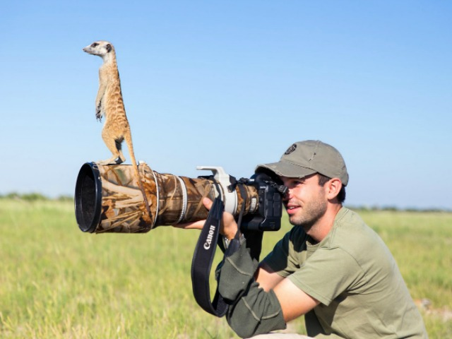 Will taking a photo with a meerkat on his lens!