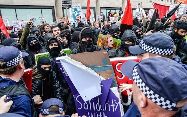 LONDON, ENGLAND - NOVEMBER 04: Protesters try to break police lines at the Department for Business, Innovation and Skills during a demonstration against education cuts on November 4, 2015 in London, England. University students from across the country are marching on the streets of London to protest against cuts to free education. After a rally outside what was the University of London Union, the march will take in Parliament Square, Milibank - occupied by student protesters five years ago - and end in front of the Department for Business, Innovation and Skills (the department responsible for universities). (Photo by Chris Ratcliffe/Getty Images)