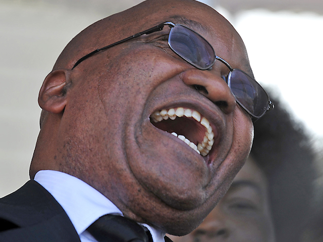 South African President Jacob Zuma laughs as he attends the swearing-in ceremony of his Mozambican counterpart Armando Guebuza for a second term in office in the capital Maputo, January 14, 2010. Guebuza has promised to relax foreign investment rules and push ahead with economic reforms, as he was sworn in for his second term on Thursday and said fighting poverty was his priority. REUTERS/Grant Lee Neuenburg (MOZAMBIQUE - Tags: POLITICS)