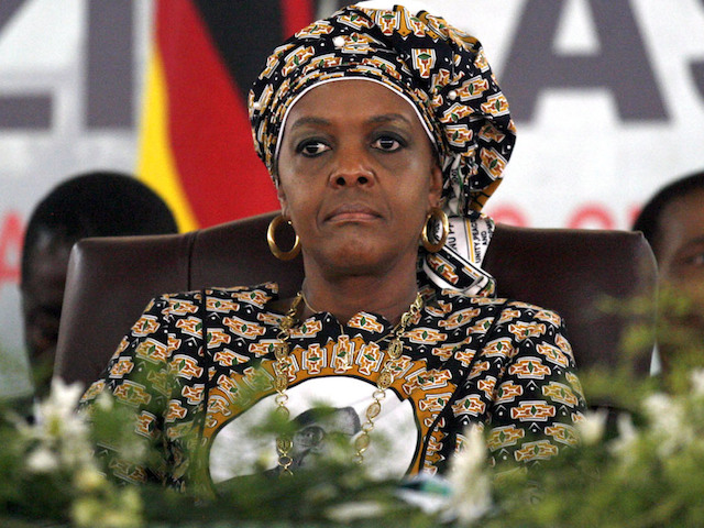 epa04518454 A picture dated 06 December 2014 shows Zimbabwean first lady Grace Mugabe following proceedings during the last day of the Zanu PF 6th people's congress in Harare, Zimbabwe. Zimbabwean President Robert Mugabe was confirmed on 06 December as the leader of the ruling Zanu-PF party while his wife was also given a high-level position, boosting her chances of succeeding her husband. Grace Mugabe was endorsed as the head of the powerful Zanu-PF Women's League at a party congress. The 49-year-old has emerged as a possible successor to her 90-year-old husband, sidelining popular Vice President Joice Mujuru, whom Robert Mugabe has accused of plotting to assassinate him. In addressing the gathering Mugabe attacked the British government and that Zimbabwe will never be a colony again.  EPA/AARON UFUMELI