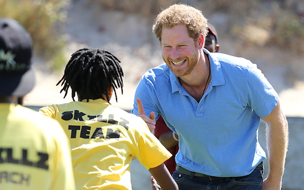 Prince Harry plays with children from local communities at the Football for Hope Centre in the Khayelitsha Township on the first day of his visit to South Africa. PRESS ASSOCIATION Photo. Picture date: Monday November 30, 2015. See PA story ROYAL Harry. Photo credit should read: Chris Radburn/PA Wire