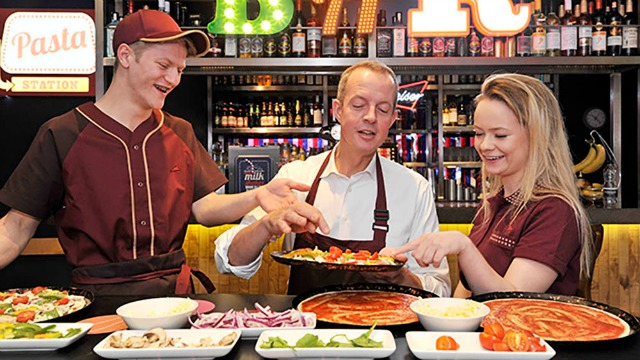 Skills Minister Nick Boles MPlearns to make a pizzawith new apprentices Alexia Seabrook from Wellingborough, Northants and Jarod Pratt from Basingstoke both aged 18 to mark the launch of Pizza Hut Restaurants' first apprenticeship programme which will offer degree level qualifications - a first for the restaurant sector. Pictured at the Pizza Hut Restaurants in the Strand, London today . This photo may only be used in for editorial reporting purposes for the contemporaneous illustration of events, things or the people in the image or facts mentioned in the caption. Re-use of the picture may require further permission from the copyright holder. Photo credit should read: Adrian Brooks/Imagewise