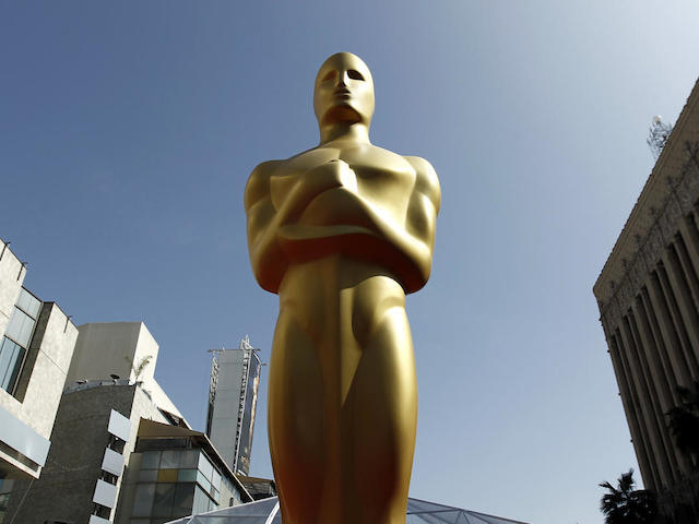 FILE - This Feb. 26, 2012 file photo, shows an Oscar statue on the red carpet before the 84th Academy Awards in Los Angeles. The 88th Academy Awards nominations will be announced on Thursday, Jan. 14, 2016, at 5:30 a.m. PST in the Academy's Samuel Goldwyn Theater in Beverly Hills, Calif. The Oscars will be presented on Feb. 28, 2016, in Los Angeles. (AP Photo/Matt Sayles, File)