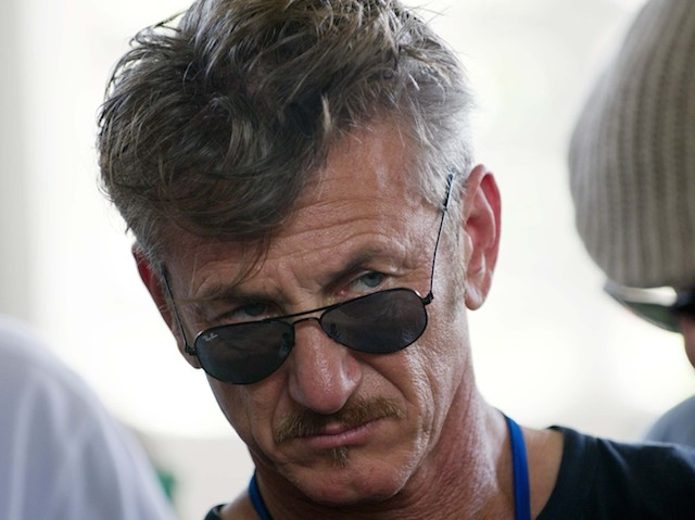 Actor Sean Penn (C) tours the Lime Nursery and Grafting Project in Mirebalais, in the central plateau of Haiti, on February 23, 2015. AFP PHOTO/HECTOR RETAMAL         (Photo credit should read HECTOR RETAMAL/AFP/Getty Images)