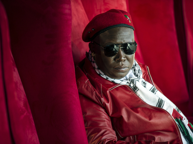 "Julius Malema, ""Commander in Chief"" of the South African political party Economic Freedom fighters (EFF), looks on before addressing a crowd of about 3,000 EFF supporters gathered during a rally to mark the party's first anniversary in Thokoza Park in Soweto on July 26, 2014.  AFP PHOTO / MUJAHID SAFODIEN"