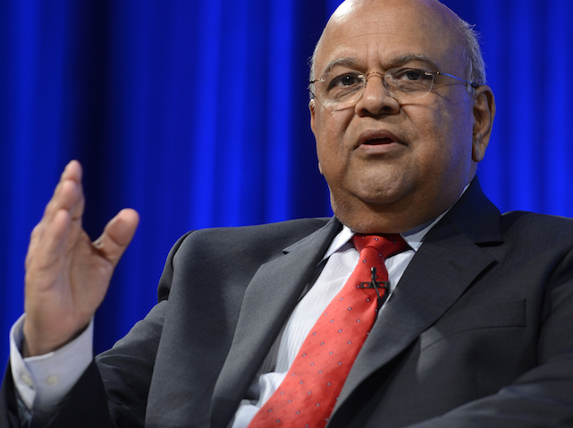 epa03903643 South African Finance Minister Pravin Gordhan delivers remarks at a panel discussion titled From Poverty to Prosperity during the IMF World Bank Annual Meetings 2013 in Washington, DC, USA, 09 October 2013. The Annual meetings run through Saturday 12 October 2013.  EPA/SHAWN THEW