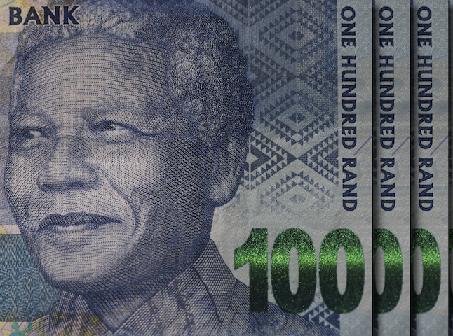 epa03643485 A section of the new one hundred Rand note featuring the face of former president Nelson Mandela is pictured in Cape Town, South Africa 28 March 2013. The new range of bank notes released from the South African Reserve Bank and commonly known as 'Randelas' feature the face of Mandela on all five rand notes. Nelson Mandela was admitted to an undisclosed hospital on 28 March 2013 for the third time in four months for a recurring lung infection, as reported in a government's statement.  EPA/NIC BOTHMA