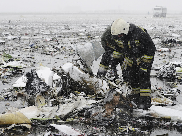 Emergencies Ministry members search the wreckage at the crash site of Flight number FZ981, a Boeing 737-800 operated by Dubai-based budget carrier Flydubai, at the airport of Rostov-On-Don, Russia, March 19, 2016. REUTERS/Stringer  EDITORIAL USE ONLY. NO RESALES. NO ARCHIVE