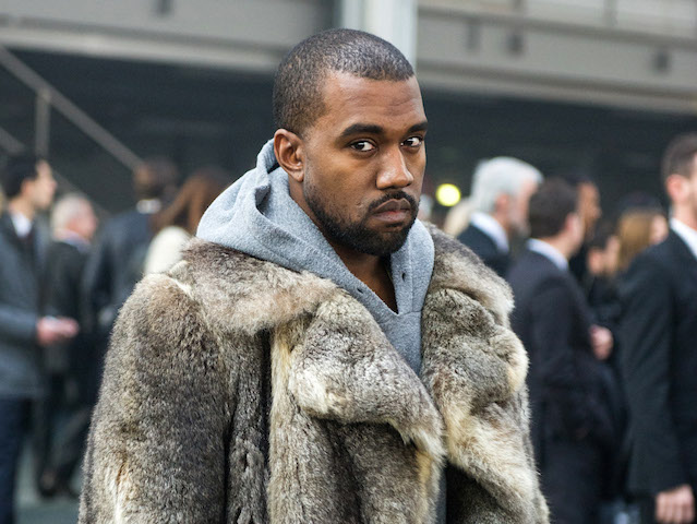 FILE - This Jan. 17, 2014 file photo shows singer Kanye West as he arrives for the Givenchy men's Fall-Winter 2014-2015 fashion collection in Paris.  West will not face criminal charges over an incident in which he apparently punched a man in a Beverly Hills chiropractor's office, prosecutors determined Friday, Jan. 31. The Los Angeles County District Attorney's Office rejected a battery case against the rapper because he had reached a civil settlement with the man and there were no significant injuries documented after the altercation. The altercation occurred after the 18-year-old man used a racial slur in an argument with West's fiancee, Kim Kardashian, on Jan. 13, according to a document prepared by a prosecutor.  (AP Photo/Zacharie Scheurer, File) ORG XMIT: NYET631