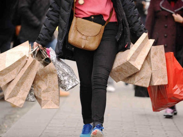 Embargoed to 0001 Tuesday November 5 File photo dated 6/12/2011 of a shopper carrying shopping bags on Oxford Street, London, as Britain's beleaguered retailers struggled to pick up sales last month as shoppers shunned seasonal fashion ranges amid gathering autumnal gloom in the sector.. Issue date: Tuesday November 5, 2013. A like-for-like rise of just 0.8% compared to a bleak period last year has left firms relying on a bumper Christmas to turn around their fortunes, according to figures from the British Retail Consortium and KPMG. The paltry improvement during October, only slightly better than the previous month, is the latest sign of a hard autumn on the high street after a buoyant summer lifted hopes of recovery. See PA story ECONOMY Retail. Photo credit should read: Dominic Lipinski/PA Wire