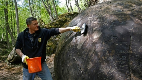 448562-suad-keserovic-cleans-stone-ball-reuters