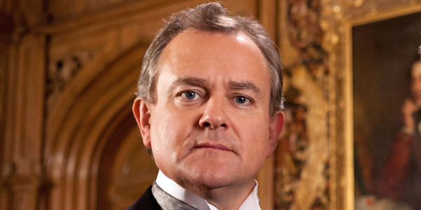 """This publicity image released by PBS shows Hugh Bonneville in a scene from the popular series """"Downton Abbey."""" Bonneville portrays the patriarchal Lord Grantham in the series, """"Downton Abbey."""" The season three finale airs Sunday, Feb., 17 on PBS. (AP Photo/PBS, Josh Barratt)"""