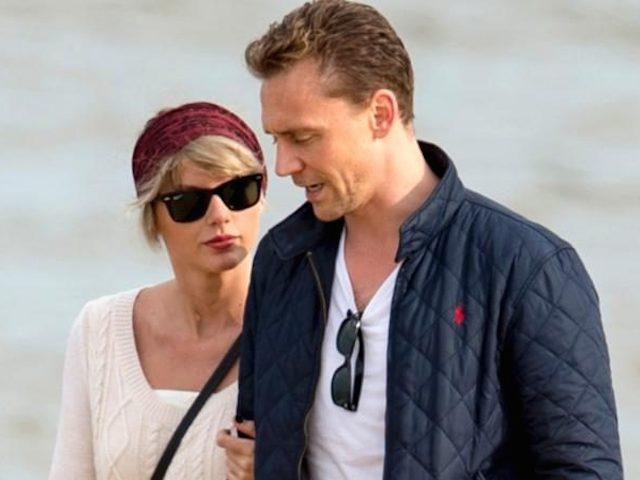 101803993_Taylor-Swift-Tom-Hiddleston-beach-NEWS-large_trans++qVzuuqpFlyLIwiB6NTmJwfSVWeZ_vEN7c6bHu2jJnT8