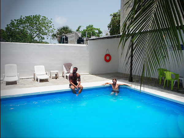 fantasy-cooling-off-in-a-serene-palm-fringed-pool-at-hostel-el-corazon-in-cancun