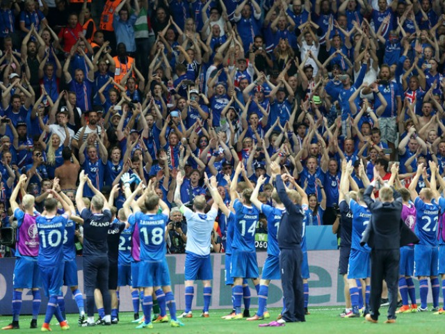 Iceland players celebrate with their supporters at the end of the Euro 2016 round of 16 soccer match between England and Iceland, at the Allianz Riviera stadium in Nice, France, Monday, June 27, 2016. (AP Photo/Claude Paris)