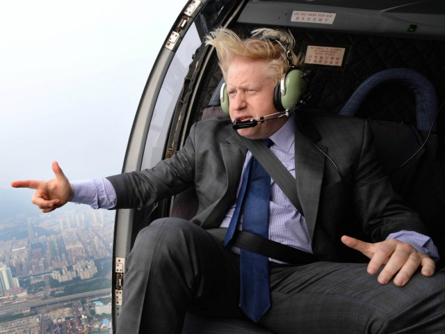 Mayor of London Boris Johnson takes a helicopter ride over Hong Kong as part of week long visit to China to promote trade between the far east and London. PRESS ASSOCIATION Photo. Picture date: Thursday October 17, 2013. See PA story POLITICS China. Photo credit should read: Andrew Parsons/PA Wire