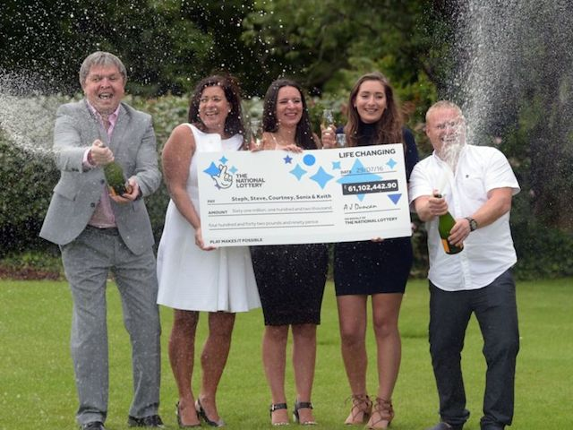 Members of the Davies family who scooped a £61.1 million EuroMillions jackpot celebrate their win at the Celtic Manor Resort in Newport, south-east Wales. PRESS ASSOCIATION Photo. Picture date: Wednesday August 3, 2016. See PA story LOTTERY EuroMillions. Photo credit should read: Ben Birchall/PA Wire