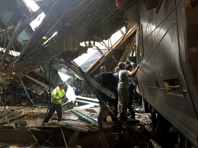 HOBOKEN, NJ - SEPTEMBER 29:  Train personel survey the NJ Transit train that crashed in to the platform at the Hoboken Terminal September 29, 2016 in Hoboken, New Jersey. (Photo by Pancho Bernasconi/Getty Images)