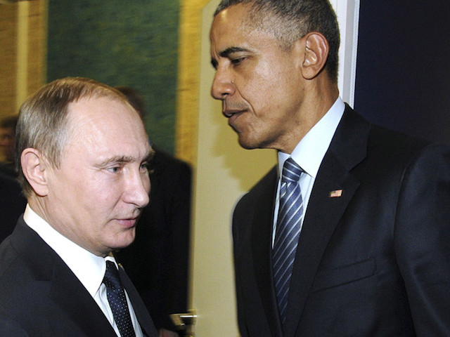 Russian President Vladimir Putin (L) shakes hands with U.S. President Barack Obama as they meet during the World Climate Change Conference 2015 (COP21) at Le Bourget, near Paris, France, November 30, 2015. REUTERS/Mikhail Klimentyev/Sputnik/Kremlin ATTENTION EDITORS - THIS IMAGE HAS BEEN SUPPLIED BY A THIRD PARTY. IT IS DISTRIBUTED, EXACTLY AS RECEIVED BY REUTERS, AS A SERVICE TO CLIENTS. - RTX1WI5J