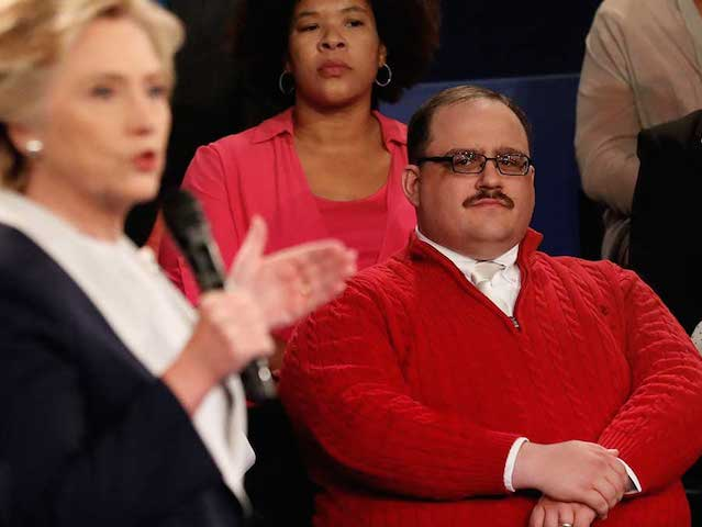 Kenneth Bone listens as Democratic presidential nominee Hillary Clinton answers a question during the second presidential debate with Republican presidential nominee Donald Trump at Washington University in St. Louis, Sunday, Oct. 9, 2016. (Rick T. Wilking/Pool via AP)