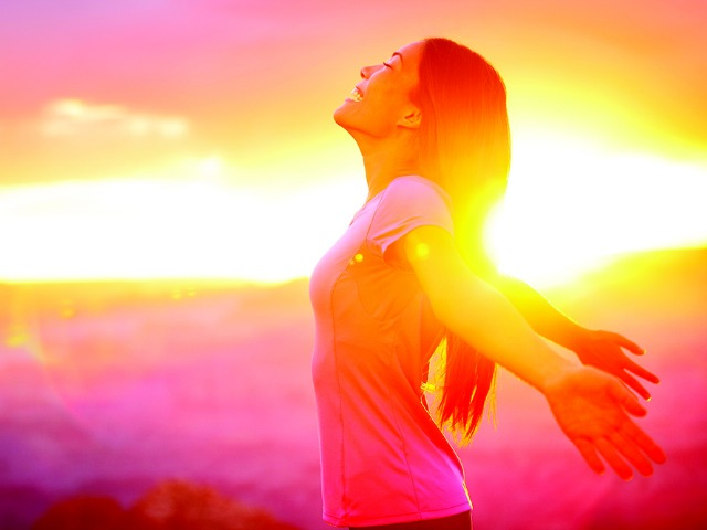 Free happy woman enjoying nature sunset. Freedom, happiness and enjoyment concept of beautiful multiracial Asian Caucasian girl in her 20s. Image from Grand Canyon, United States.